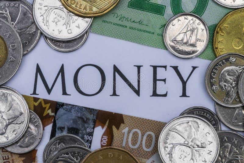 Dinheiro canadense com o dinheiro da palavra no meio fotografia de stock royalty free