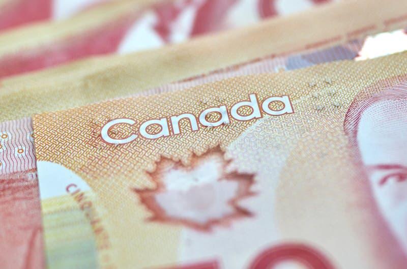 dinheiro canadense em um bolso do calças de ganga imagens de stock royalty free