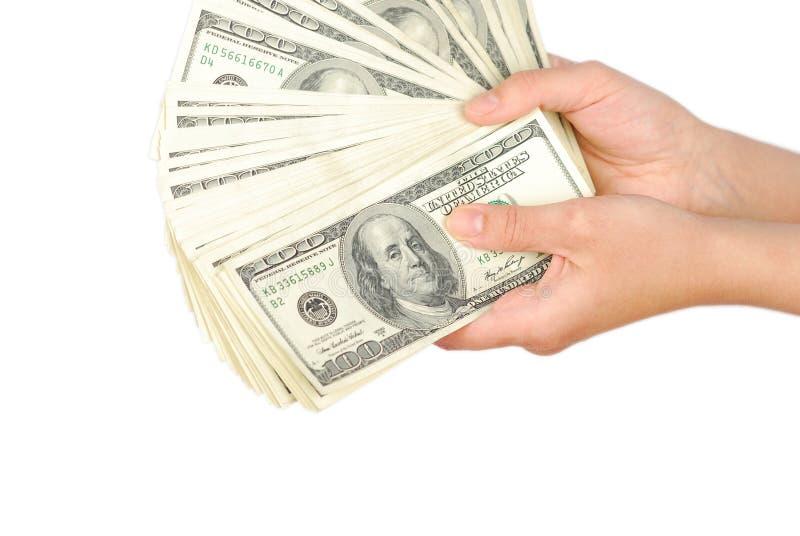 Dinheiro da cédula do dólar na mão fotos de stock