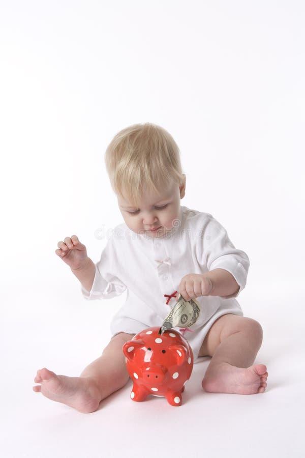 Dinheiro da economia do bebê imagem de stock