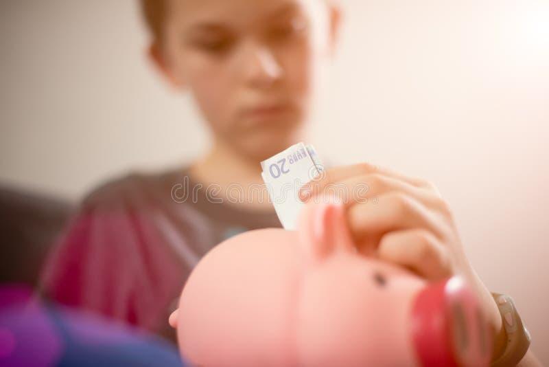 Dinheiro da economia do menino imagem de stock royalty free