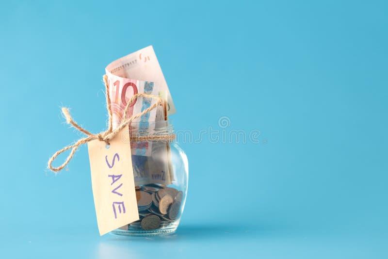 Dinheiro da economia no frasco fotografia de stock