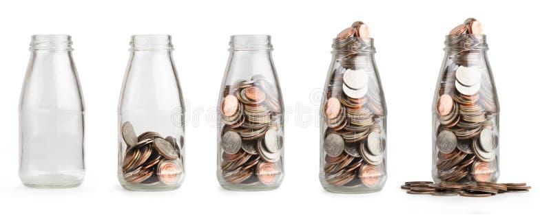 Dinheiro da moeda da economia na garrafa de vidro imagem de stock royalty free