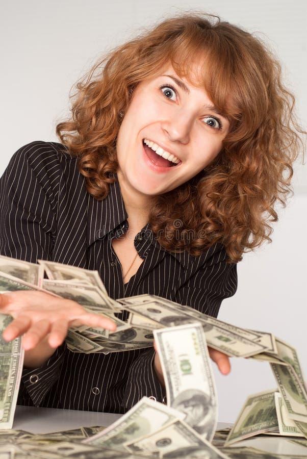 Dinheiro da terra arrendada da menina fotografia de stock royalty free