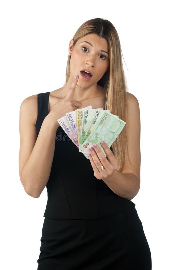 Dinheiro da terra arrendada da mulher foto de stock royalty free