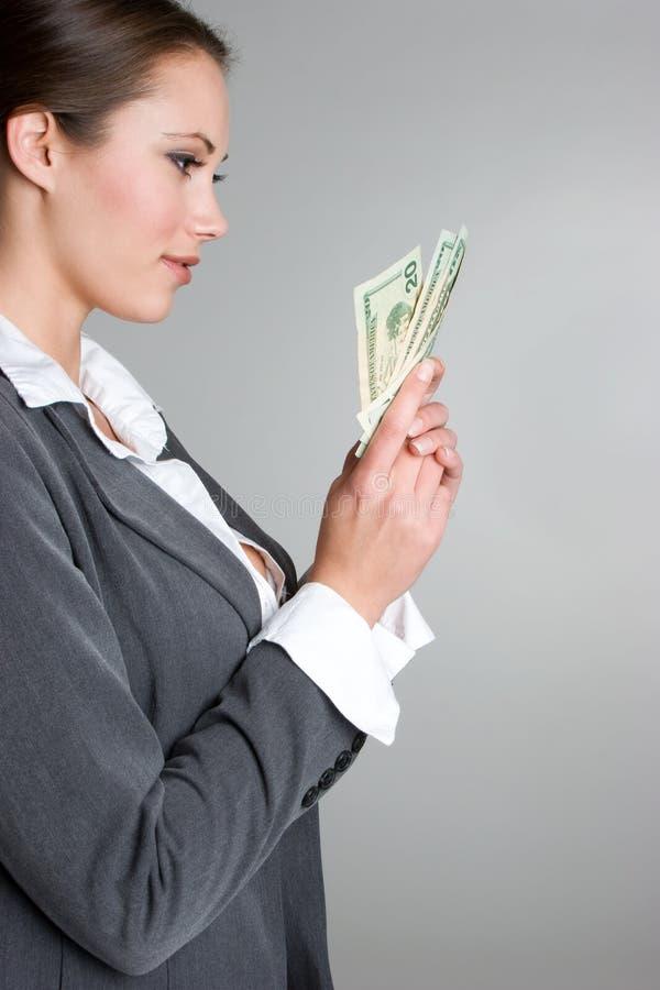 Dinheiro da terra arrendada da mulher fotos de stock royalty free