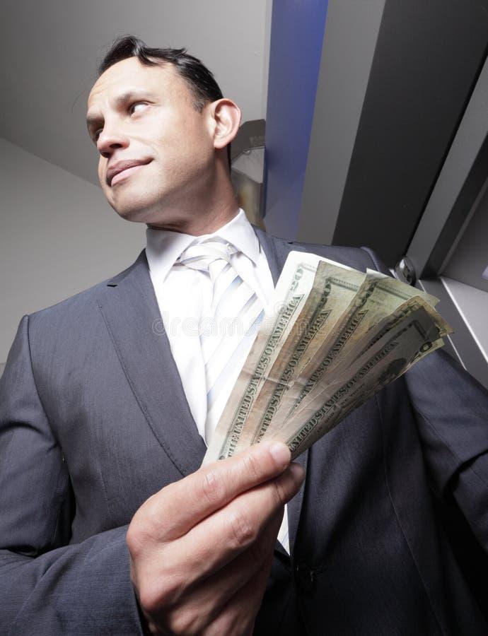 Dinheiro da terra arrendada do homem de negócios imagens de stock