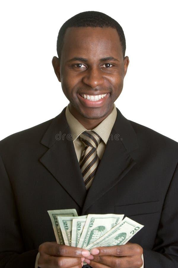 Dinheiro da terra arrendada do homem de negócios fotos de stock