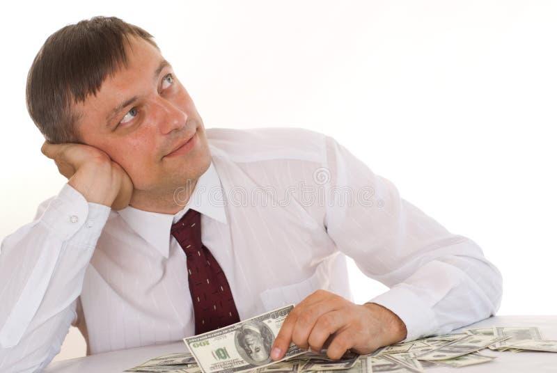 Dinheiro da terra arrendada do homem novo foto de stock royalty free