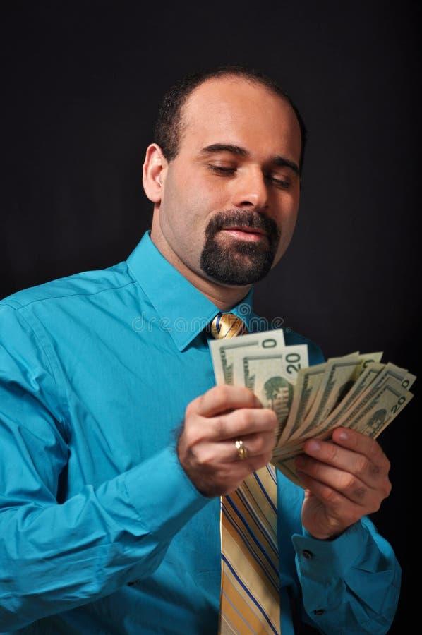 Dinheiro de Cunting fotografia de stock royalty free