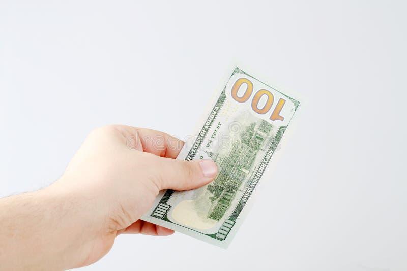 Dinheiro de Holdnig da mão fotografia de stock royalty free