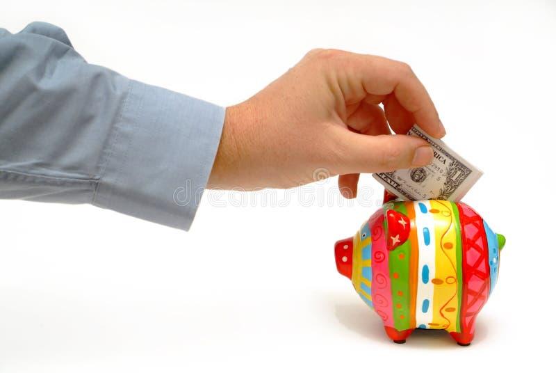 Dinheiro do dinheiro da economia do homem de negócios com banco piggy foto de stock royalty free
