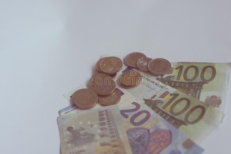 Dinheiro do Euro na tabela branca fotografia de stock royalty free