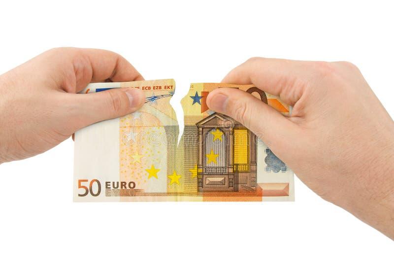 Dinheiro do rasgo das mãos imagem de stock royalty free