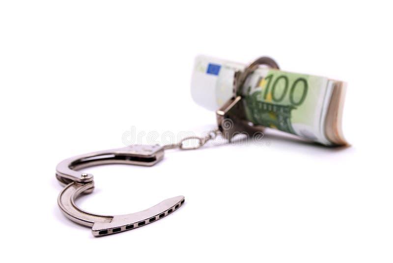 Dinheiro e algemas fotografia de stock royalty free