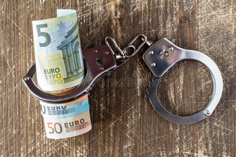 Dinheiro e algemas fotos de stock royalty free
