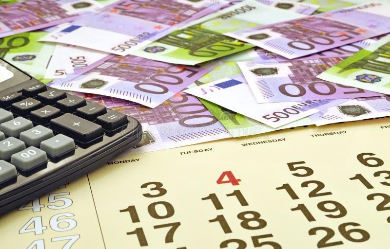 Dinheiro e calculadora imagem de stock royalty free