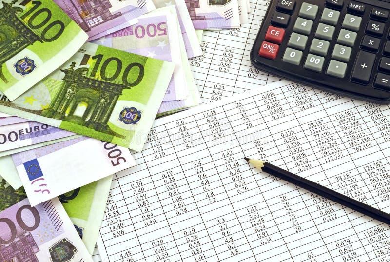 Dinheiro e calculadora fotografia de stock royalty free