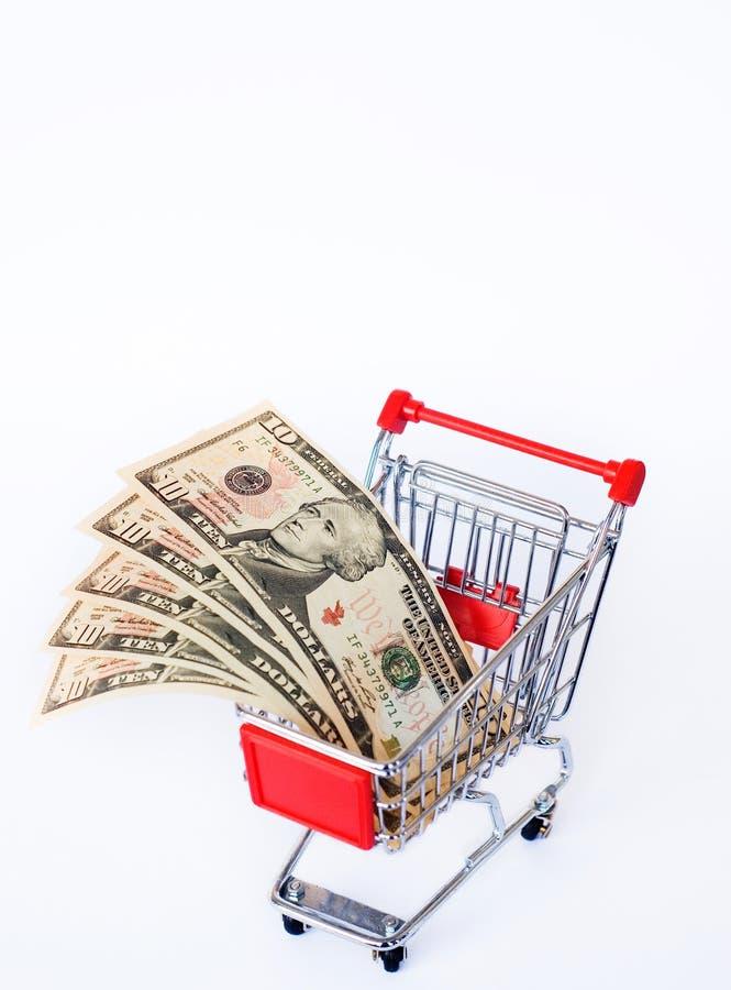 Dinheiro e carro de compra imagem de stock royalty free
