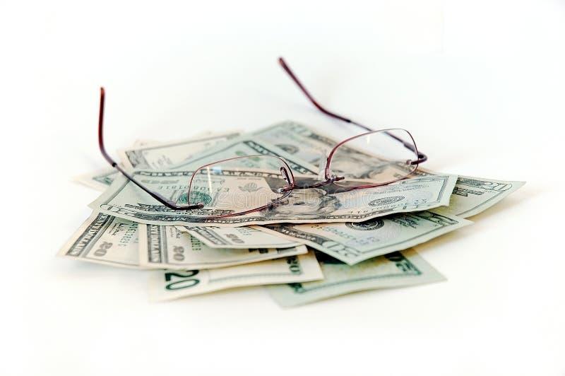 Dinheiro e Eyeglasses imagens de stock