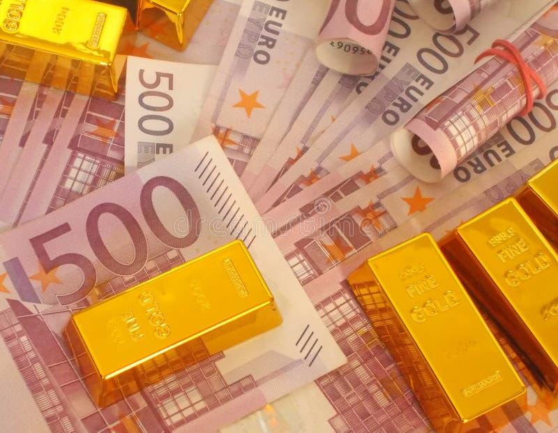 Dinheiro e ouro fotografia de stock
