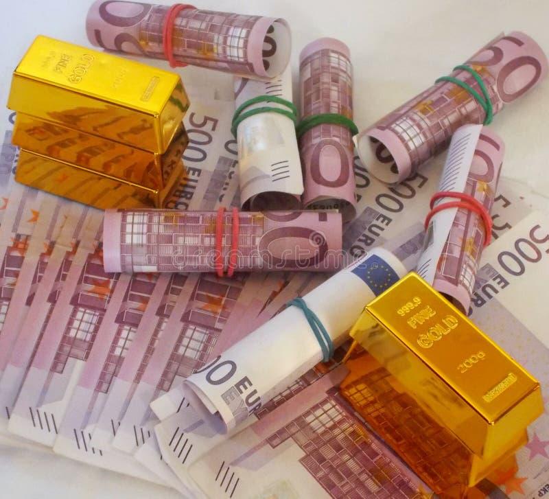 Dinheiro e ouro imagens de stock royalty free