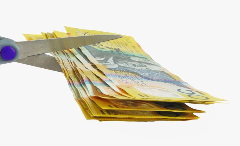 Dinheiro e tesouras fotografia de stock