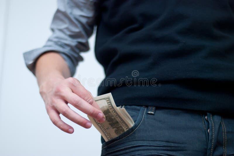 Dinheiro em um bolso fotos de stock