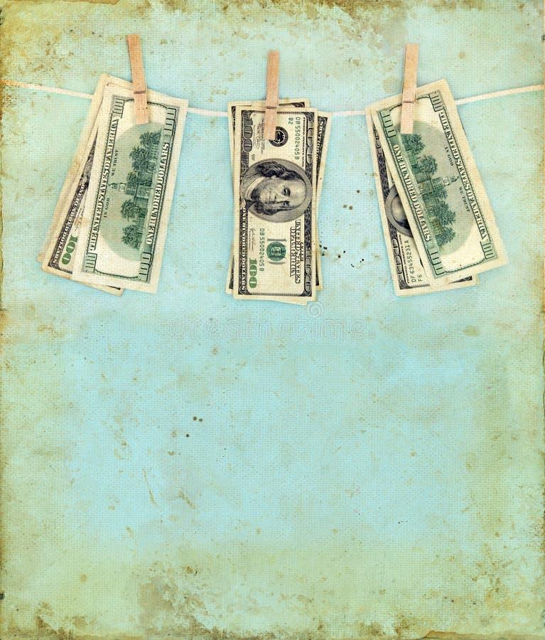 Dinheiro em um Clothesline com fundo de Grunge imagem de stock royalty free
