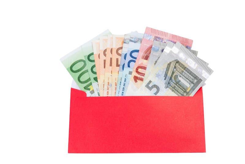 Dinheiro em um envelope vermelho brilhante fotografia de stock