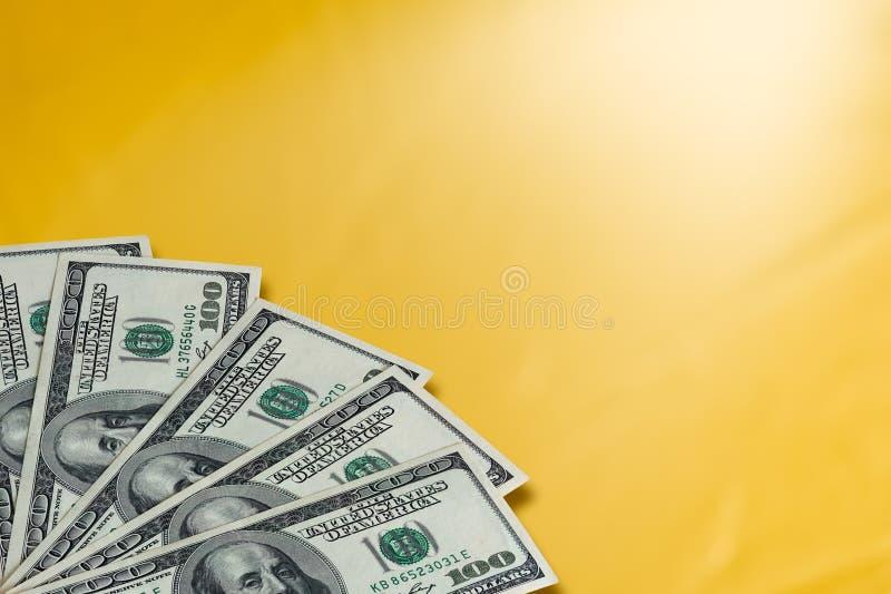 Dinheiro em um fundo dourado imagens de stock royalty free