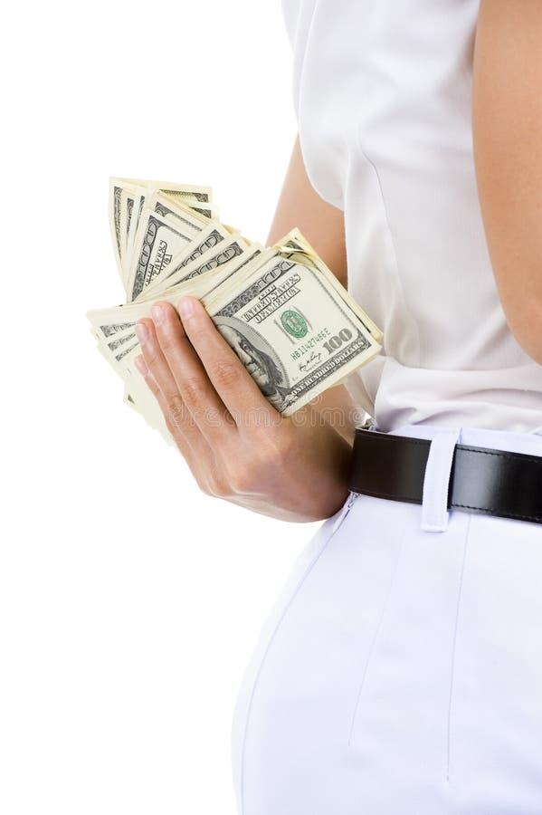 Dinheiro escondendo da mulher foto de stock
