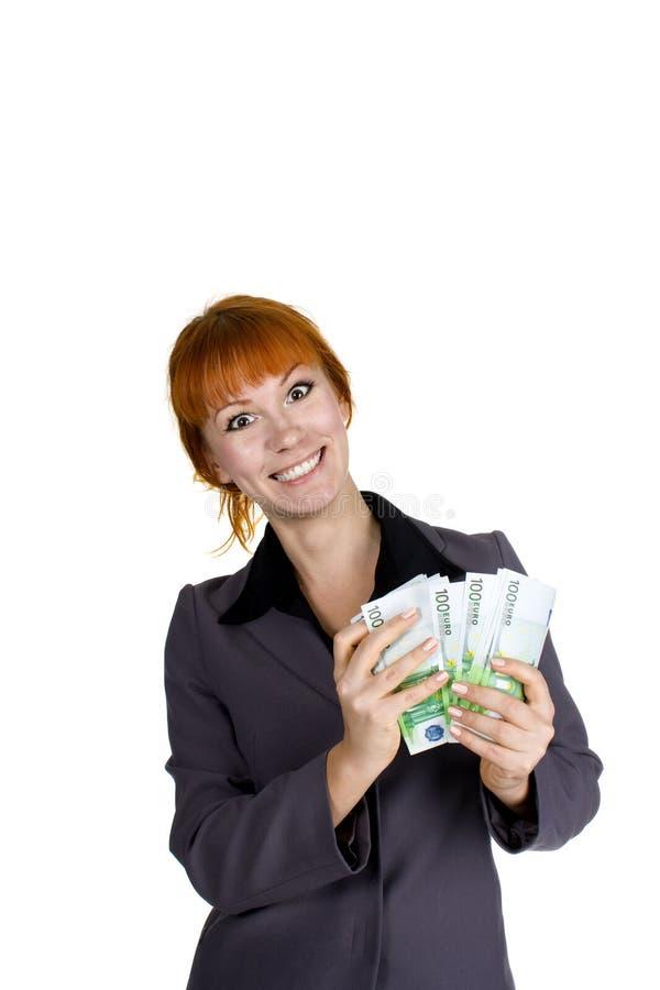 Dinheiro Excited da terra arrendada da mulher de negócios fotos de stock