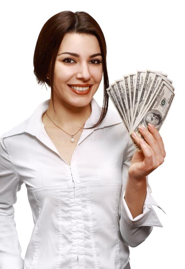 Dinheiro feliz da terra arrendada da mulher nova imagens de stock royalty free
