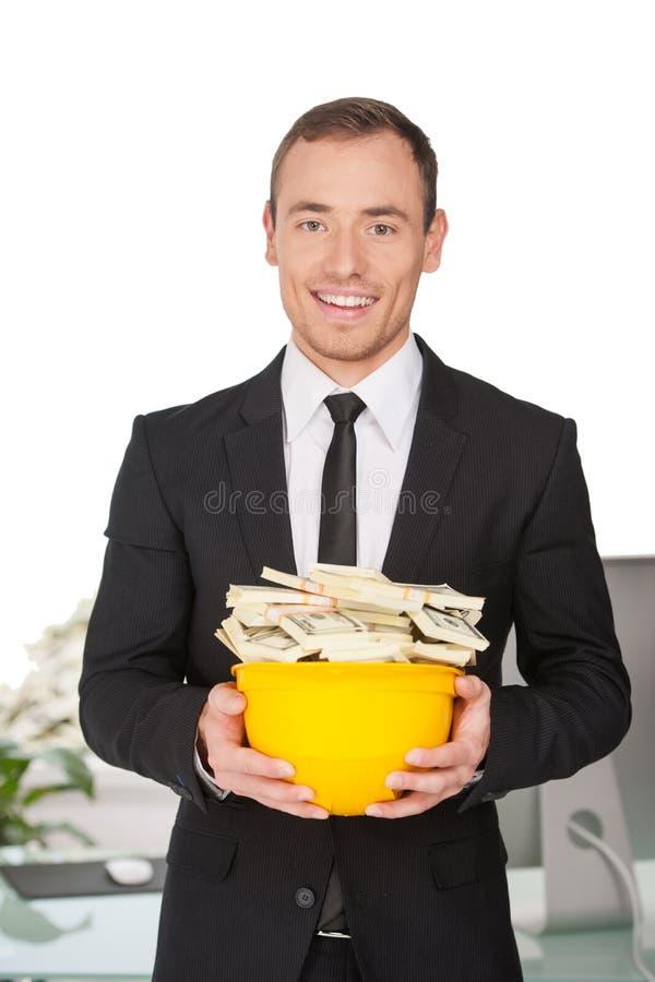 Dinheiro no capacete de segurança. fotografia de stock royalty free