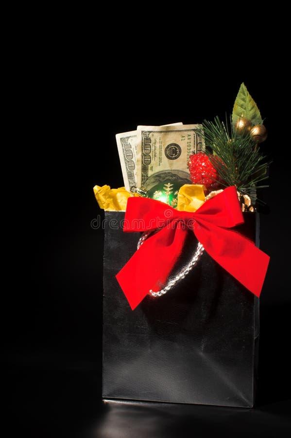 Dinheiro no presente de Natal imagens de stock