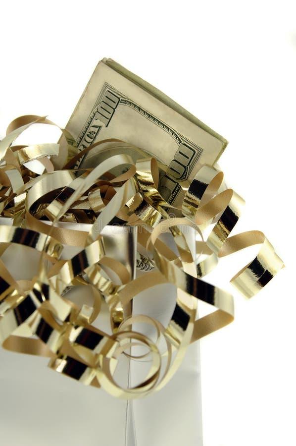 Dinheiro no saco de prata do presente fotografia de stock royalty free