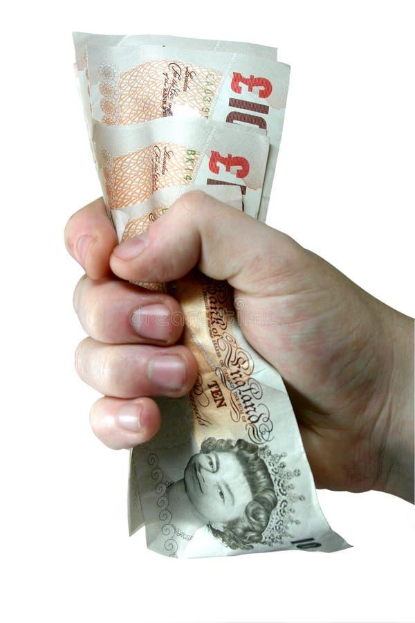 Dinheiro - notas de agarramento imagens de stock royalty free