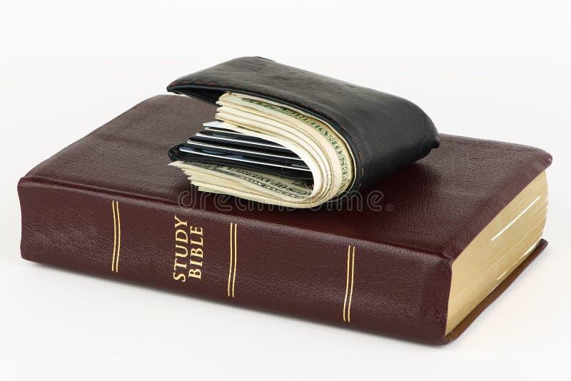 Dinheiro ou DEUS da adoração imagem de stock