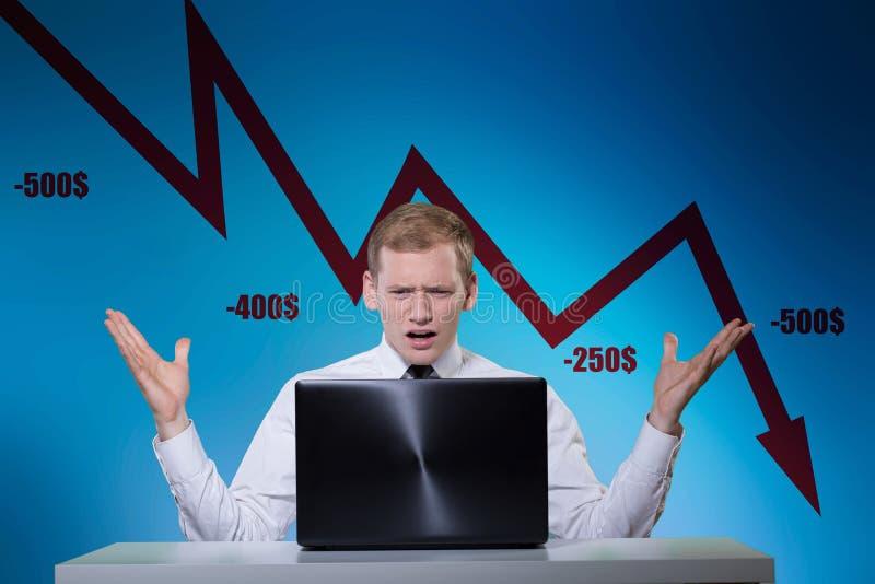 Dinheiro perdedor do banqueiro novo imagem de stock royalty free