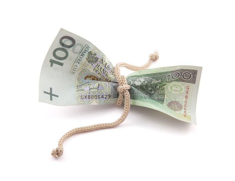Dinheiro polonês amarrado na guita imagem de stock