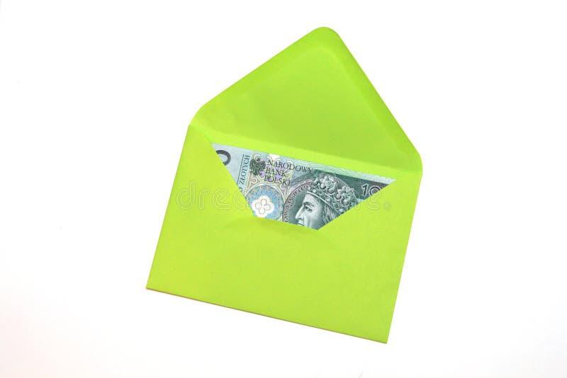 Dinheiro polonês no envelope verde imagem de stock