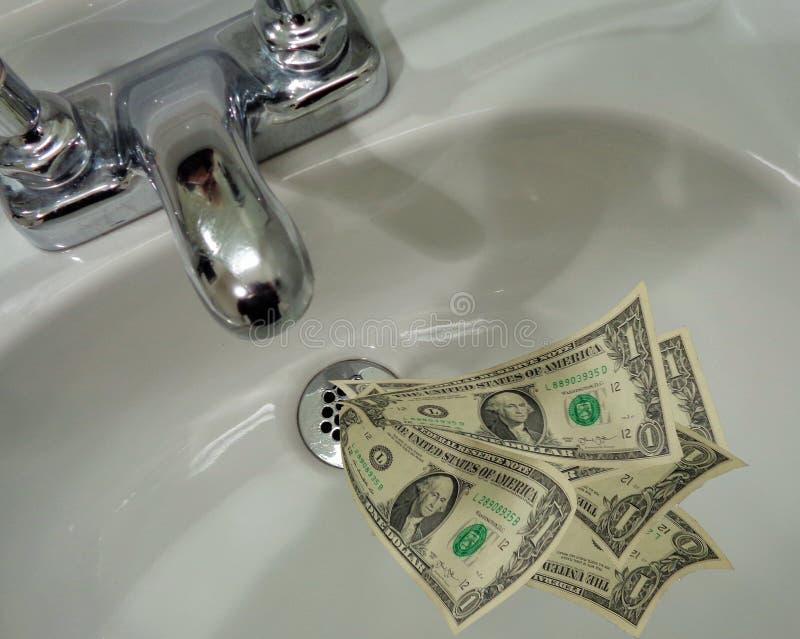 Dinheiro que vai abaixo do dreno imagem de stock royalty free