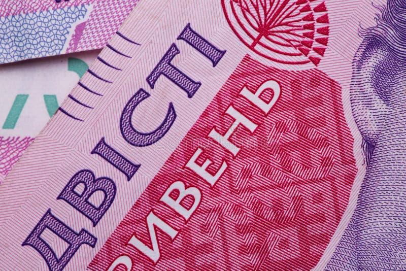 Dinheiro ucraniano Conta do papel de Hryvnia Textura do fundo Macro, close-up fotos de stock