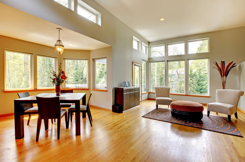 Dinig room in a modern house with many windows. royalty free stock image