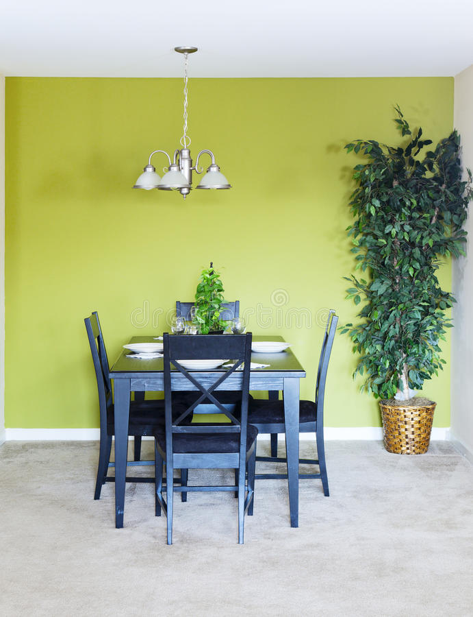 Dining area. Small dining area with black dining set and a tree royalty free stock image
