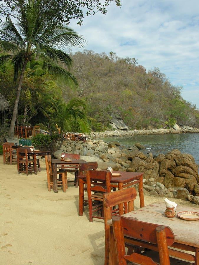 Dining on the beach stock photos