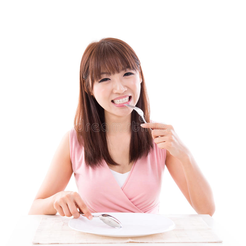 Dining concept, woman eating with empty plate stock images