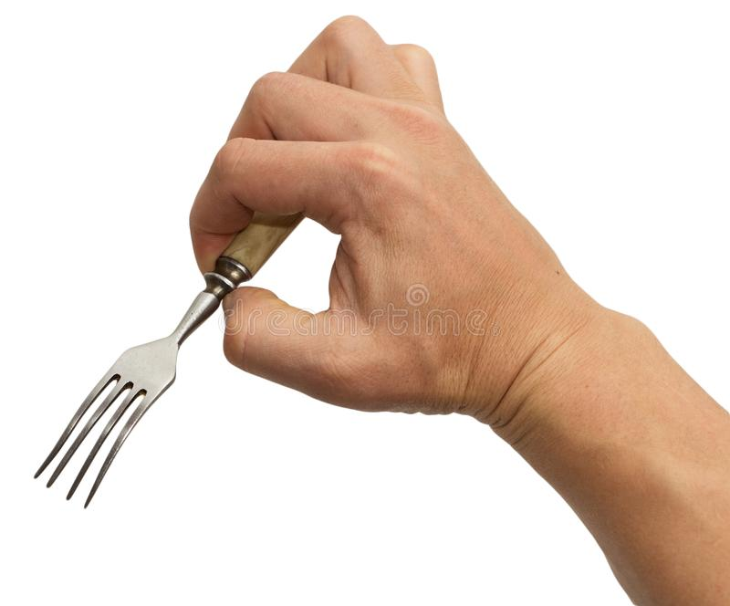 Dining fork in hand on white background stock photos