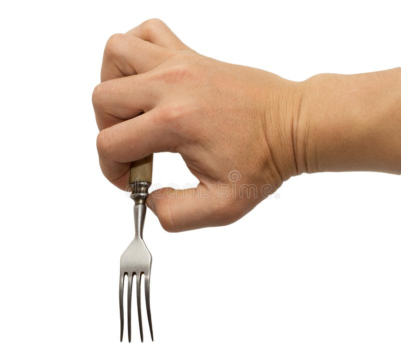 Dining fork in hand on white background stock images